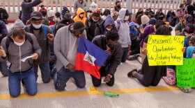 Migrants hoping to claim asylum in the United States marched from there camp at the El Chaparral border crossing to the San Ysidro port of entry and kneeled in prayer asking the Biden administration to create a process for them to make their request.