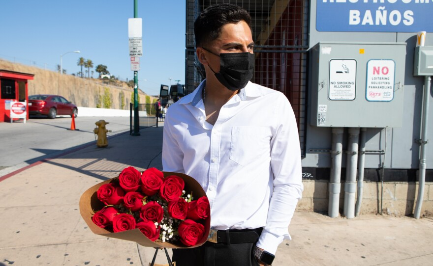 Emmanuel Alvarado waits for an Uber driver to arrive at the San Ysidro Transit Center, June 3, 2021. He was traveling from Tijuana to attend his girlfriend's high school graduation.