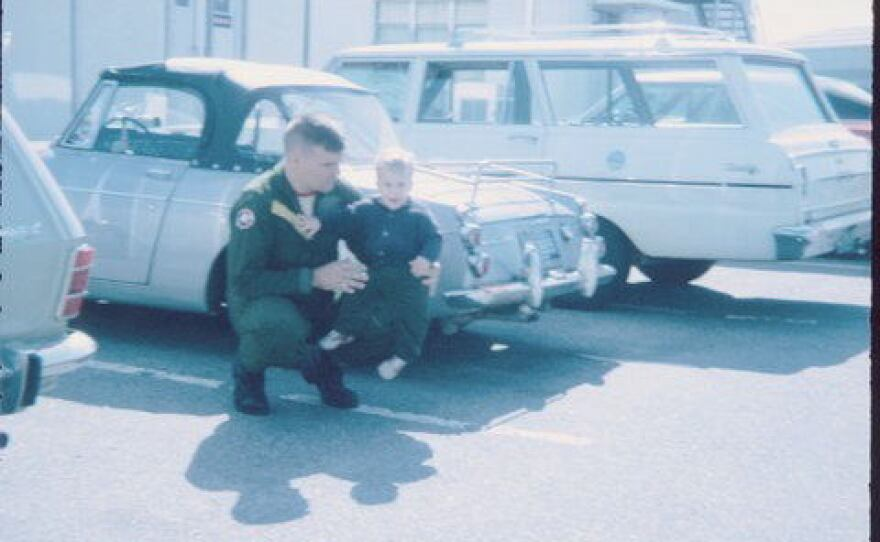 Marine Capt. Jerry Zimmer holds his son, Craig.