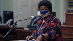 In this June 11, 2020, file photo, Assemblywoman Shirley Weber, D-San Diego, wears a face mask as she calls on lawmakers to create a task force to study and develop reparation proposals for African Americans, during the Assembly session in Sacramento, Calif.