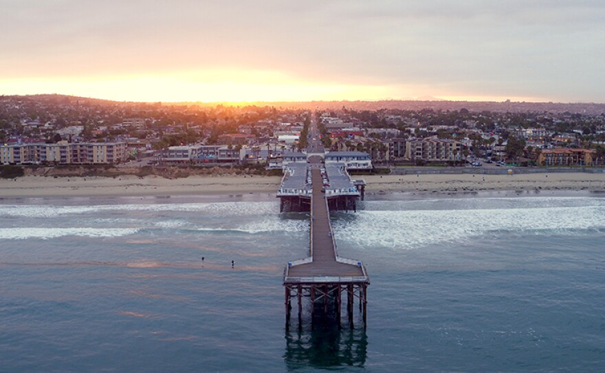 """Aerial view of sunrise over Pacific Beach pier in San Diego, Calif. Featured in the film, """"Jewel Of The Pacific."""""""