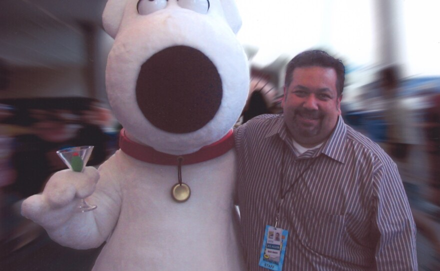 """David Glanzer may be the spokesperson for Comic-Con but he is also the type of geeky fan who will run after his favorite costumed character — Brian from """"The Family Guy"""" — to get a photo."""