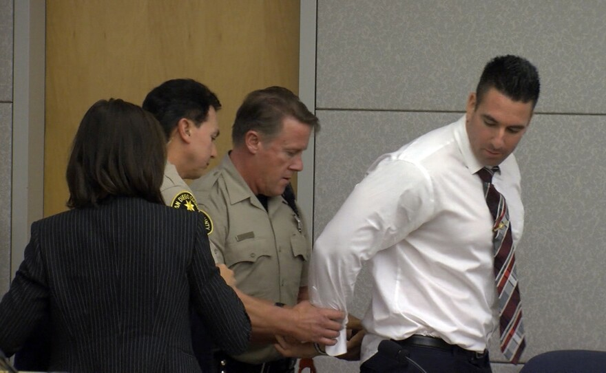 Former San Diego County sheriff's Deputy Richard Fischer being led away in handcuffs after he was sentenced to 44 months behind bars and 16 months post-release supervisions Dec. 10, 2019.