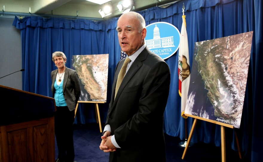 Gov. Jerry Brown responds to a question concerning the announcement by U.S. Secretary of the Interior Sally Jewell, left, that the federal government is offering up to $50 million for drought relief in western states during a news conference at the Capitol in Sacramento, Feb. 6, 2015.