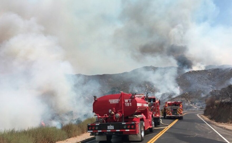 Cal Fire vehicles working on containing the Clevenger Fire on Sunday June 20, 2021 near Clevenger Canyon- San Pasqual.
