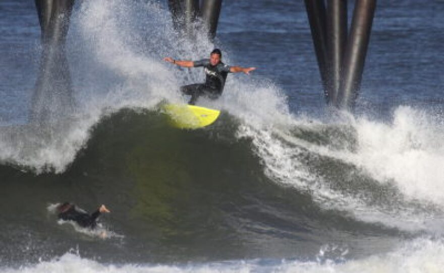 Serge Dedina surfing south of the Imperial Beach Pier in 2011.
