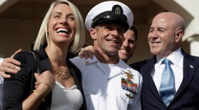 Navy Special Operations Chief Edward Gallagher, center, walks with his wife, Andrea Gallagher, left, and advisor, Bernard Kerik as they leave a military court on Naval Base San Diego, Tuesday, July 2, 2019, in San Diego. A military jury acquitted the decorated Navy SEAL Tuesday of murder in the killing of a wounded Islamic State captive under his care in Iraq in 2017.