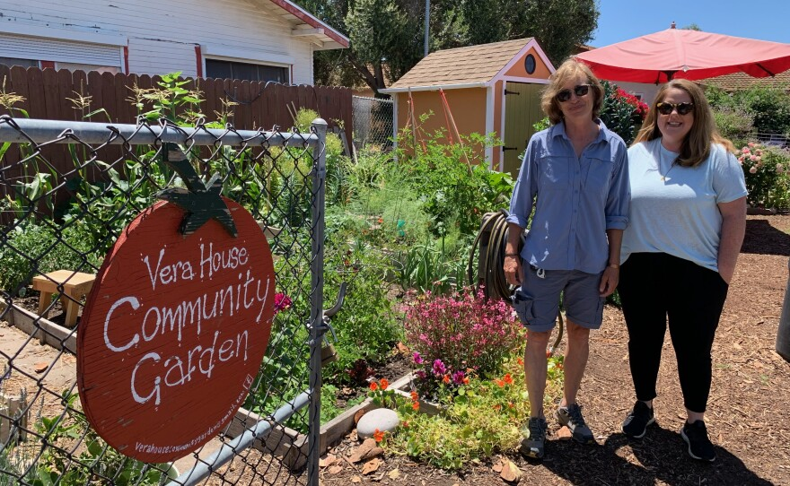 Emanuela Lisa Rossi, left, and Danielle Nuzzo Meyers stand by the entrance of the Vera House Community Garden in Normal Heights, June 11, 2021.