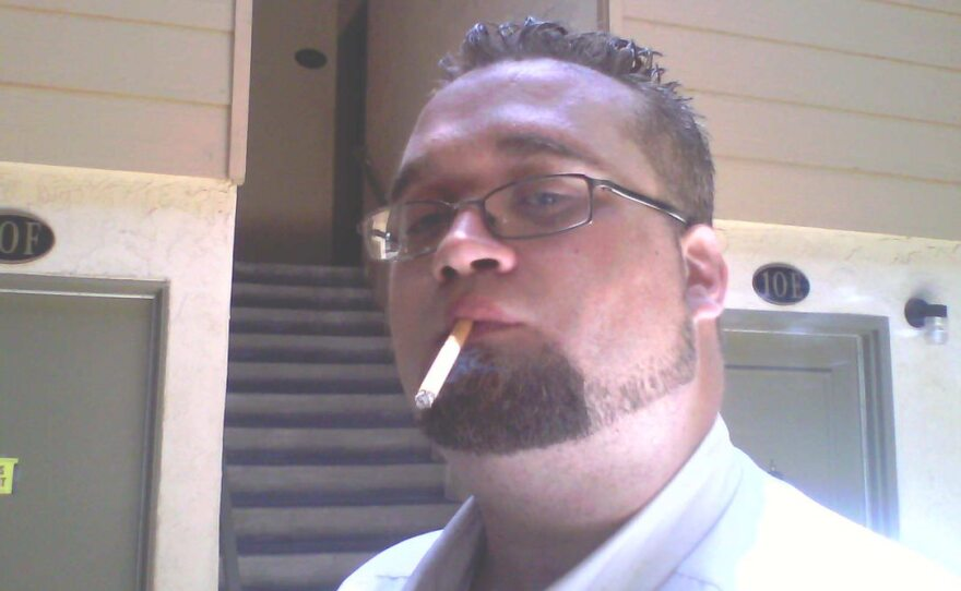 Matthew Fluckiger is pictured smoking a cigarette in this undated photo.