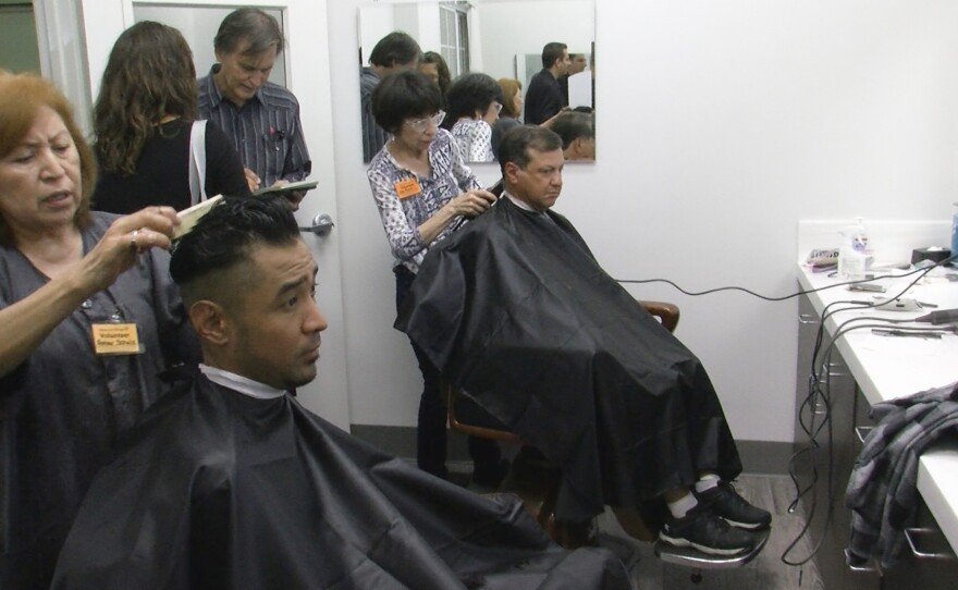 People who are homeless get haircuts at Father Joe's Villages downtown, April 23, 2019.
