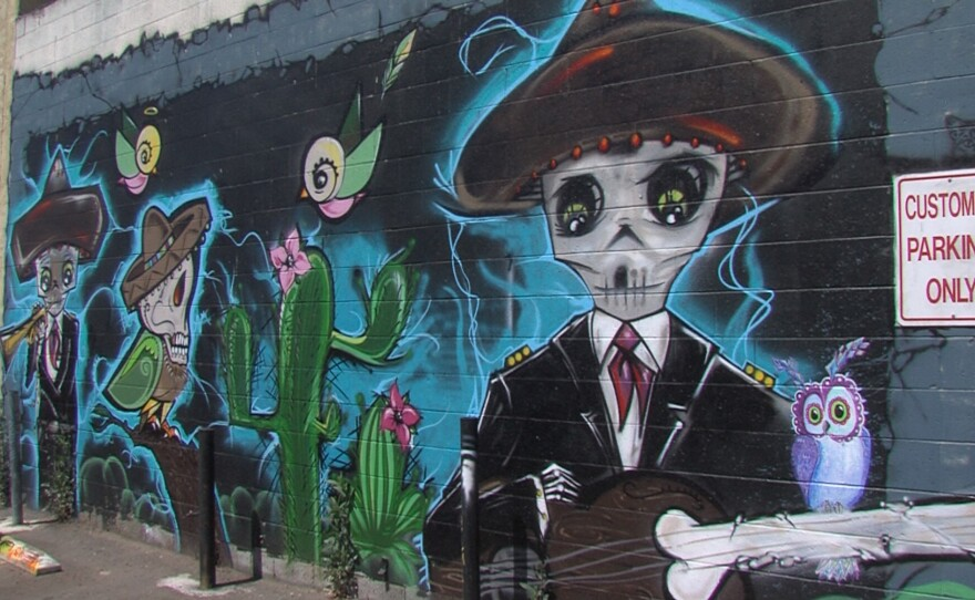 """""""The Garden Party"""" mural by Althea Rose Neff, Gilbert Cota and Alex Malone features a skeletal mariachi band on the wall of Super Cocina restaurant in City Heights, June 9, 2017."""