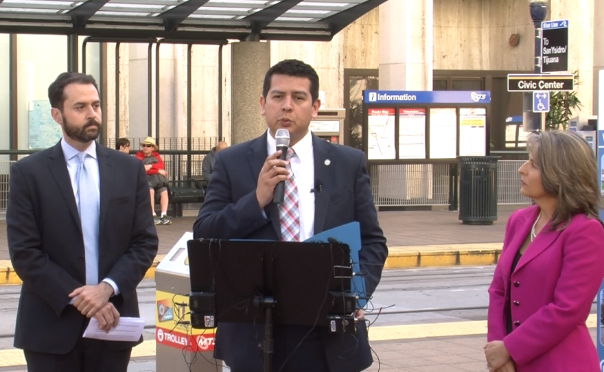 """San Diego City Councilman David Alvarez speaks at a news conference calling on MTS to """"fix the Compass Card,"""" March 8, 2016. With him are Circulate San Diego Policy Counsel Colin Parent and Councilwoman Lori Zapf."""