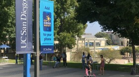 Students and faculty walk on a pathway at the UC San Diego campus, September 28, 2020.