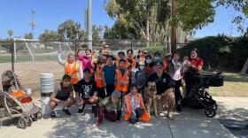 """A group of volunteers with """"Guerreras en Accion Por Un Vista Limpio"""" pose at Luz Duran Park in Vista. July 28, 2021."""