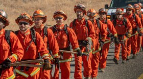 California inmate firefighters help with a controlled burn at Eastman Lake in Madera County in May 2021.