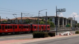 A trolley passes through Encanto in this undated photo.