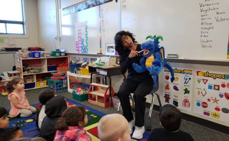 Dental hygienist Deborah Delfino shows a group of preschoolers in Lathrop, California how to brush their teeth by demonstrating with a puppet named Bob in this undated photo.