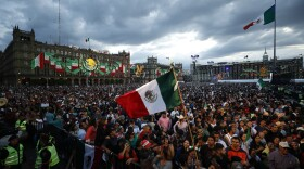 People pack the Zocalo ahead of the annual independence shout from the balcony of the National Palace that kicks off Independence Day celebrations, in Mexico City, Sunday, Sept. 15, 2019.