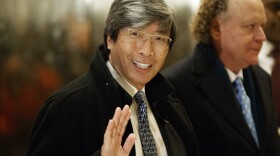 Pharmaceuticals billionaire Dr. Patrick Soon-Shiong waves as he arrives in the lobby of Trump Tower in New York for a meeting with President-elect Donald Trump, Jan. 10, 2017.