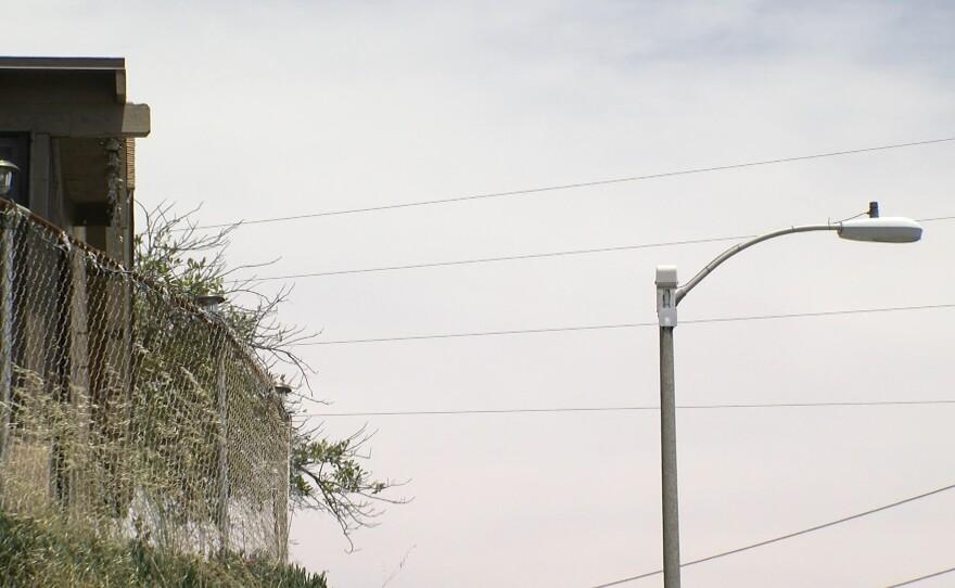 ShotSpotter listening device pictured atop light pole, June 17, 2019.