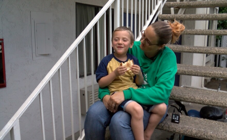 Desiree Young and her son sit on a staircase at the Carlsbad Village Inn where they are clients of the Oceanside Homeless Resource shelter. June 21, 2021.