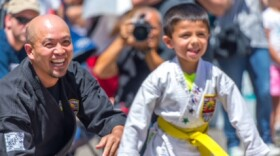 2015 Asian Pacific American Heritage Month Local Hero Daniel Hoang with one of his students from USSD Team Focus.