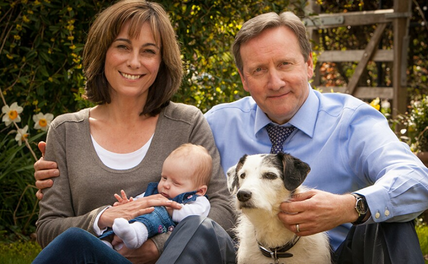 Sarah (Fiona Dolman on left), DCI John Barnaby's (Neil Dudgeon on right) wife of more than 10 years, is the headmistress of the Causton Comprehensive School in Midsomer county and lives with John and their dog Sykes in a large country cottage. This season, Sarah and John welcome their new daughter, Betty, (center) to the world!