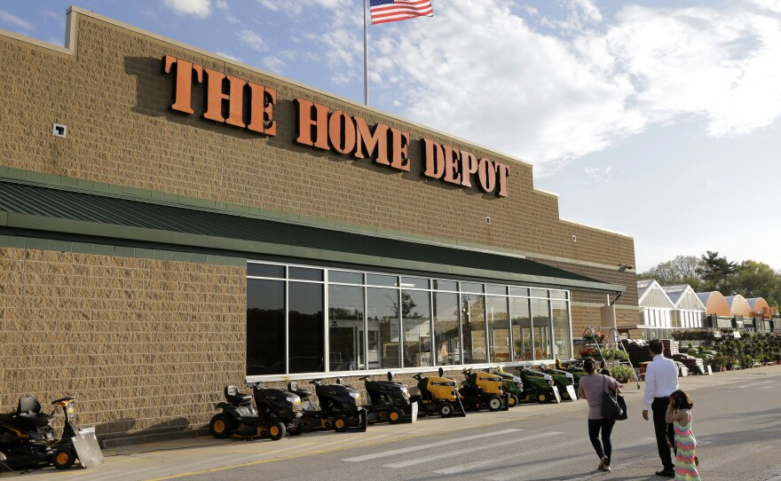 In this May 18, 2016, file photo, people approach an entrance to a Home Depot store in Bellingham, Mass.
