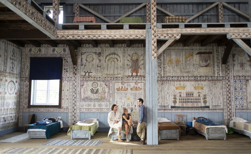 """Actors Vilhelm Blomgren and Florence Pugh on the set of """"Midsommar"""" with director Ari Aster. Make sure you appreciate the amazing production design of the film."""