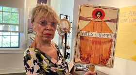 Anne Hoiberg holds a political sign for women's suffrage at The Women's Museum Of California on June 3, 2020.