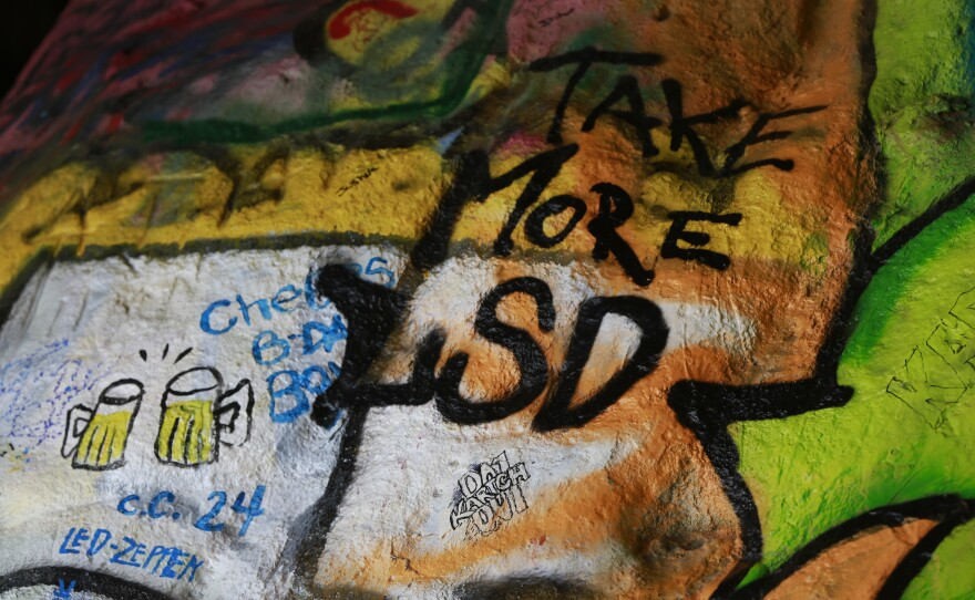Graffiti with alcohol and drugs themes are seen inside the Corral Canyon Cave in Malibu, Calif., Friday, May 6, 2016.