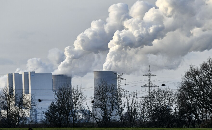 Steam blows from the RWE Niederaussem lignite-fired power station in Bergheim, Germany, in January 2020. Scientists from the National Oceanic and Atmospheric Administration say the concentration of greenhouse gases was the highest on record.