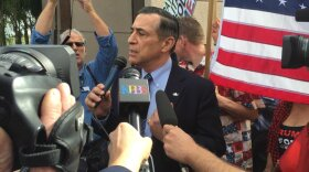 Rep. Darrell Issa, R-Vista talks to supporters and protesters outside of his Vista office, Feb. 21, 2017.