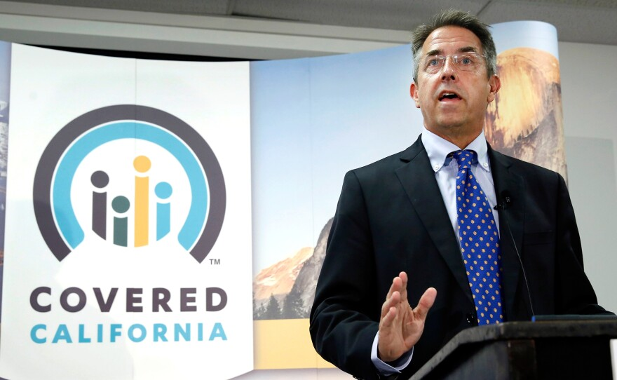 In this Nov. 13, 2013, file photo, Peter Lee, executive director of Covered California, the state's health insurance exchange, talks at a news conference in Sacramento, Calif.