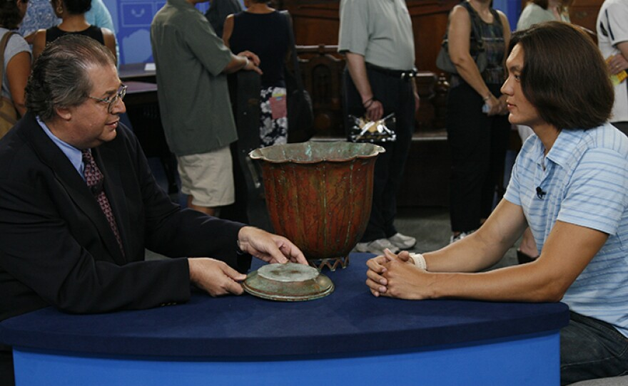 Eric Silver (left) appraises a Dirk van Erp copper vase, ca. 1930 in Honolulu, Hawaii.