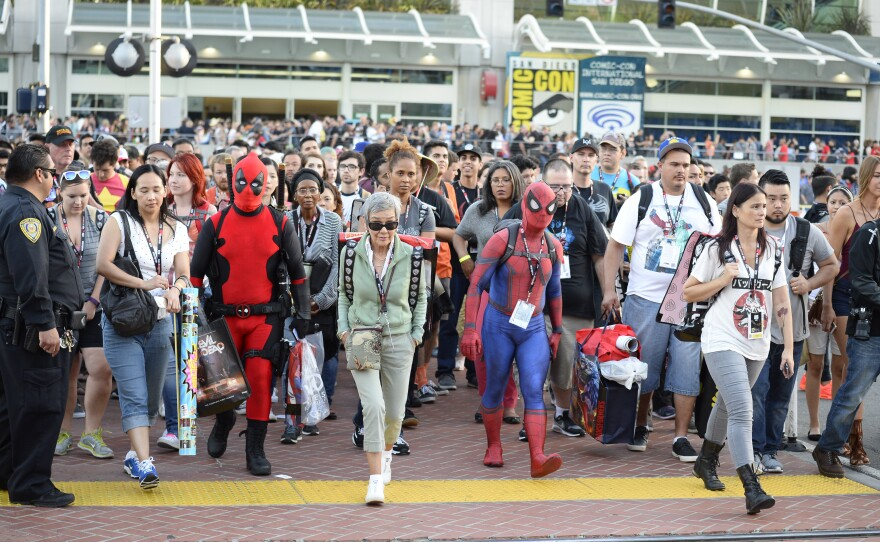 Fans leave the convention center on Day One of Comic-Con International held at the San Diego Convention Center, July 21, 2016.