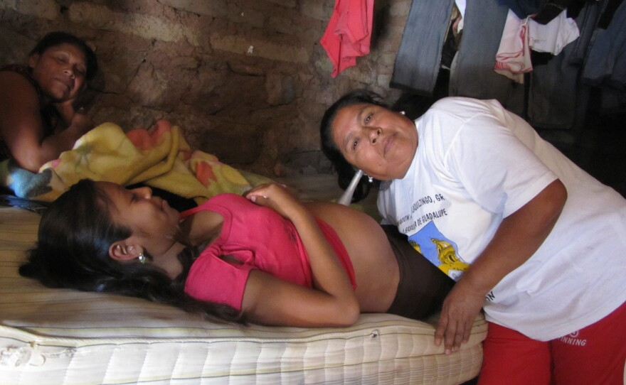 Macrina Martinez listens to an unborn baby's heart beat. She is the village midwife in Tlatquiltzingo, Guerrero.