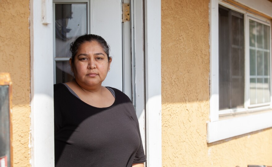 Patty Mendoza is shown in the doorway of her Imperial Beach apartment, March 23, 2021.
