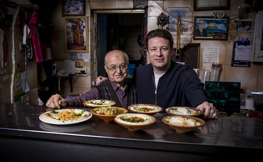 Host Jamie Oliver (right) learns about food cultures around the world that center vegetables.