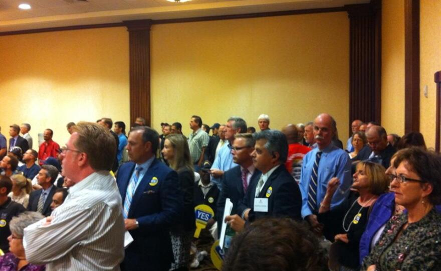 The crowd inside the meeting to determine the convention center expansion.