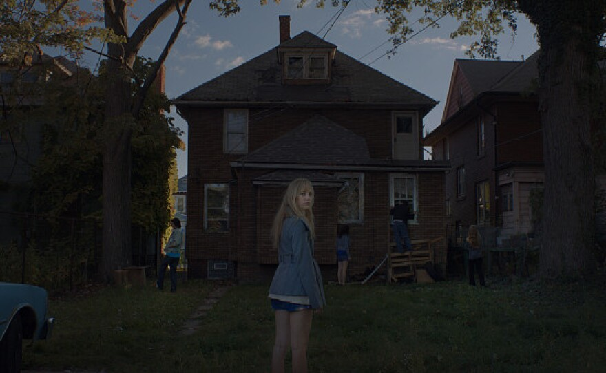 """In the new horror film """"It Follows,"""" Maika Monroe plays Jay, a young woman who tries to uncover the source of a nightmarish vision she has been haunted by ever since a seemingly innocent sexual encounter with a young man. In the pictured scene, she and her friends try to find the young man who mysteriously vanished from town."""