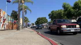 Cars drive down a block of El Cajon Boulevard where San Diego officials plan on widening the road with a new right-turn lane, Sept. 2, 2021.