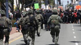 San Diego police officers walk towards a group of protesters, June 1, 2020.