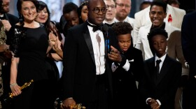 """Barry Jenkins, writer-director for """"Moonlight,"""" onstage after hearing that """"La La Land"""" did not win the Oscar for Best Picture, but rather """"Moonlight"""" had."""