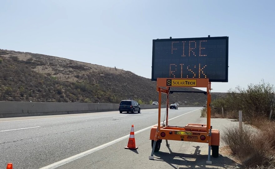 Sign on Highway 76 near Fallbrook and Bonsall warning of SDGE power outages and fire risk. October 26, 2020