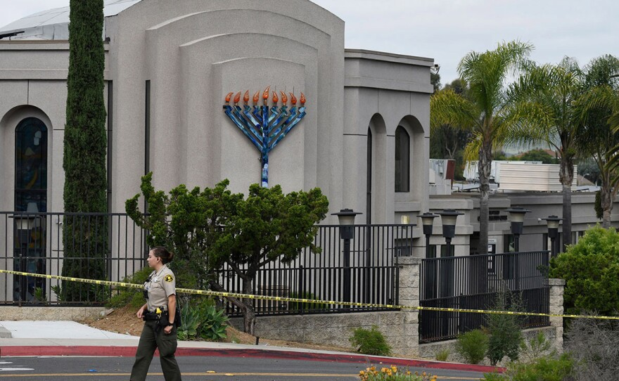 A San Diego county sheriff's deputy stands in front of the Chabad of Poway synagogue, Sunday, April 28, 2019.