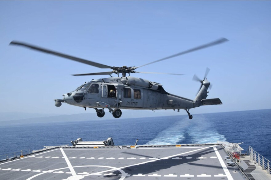 An MH-60S Sea Hawk helicopter, assigned to Helicopter Sea Combat Squadron (HSC) 28 Detachment Five, takes off from the flight deck of the Spearhead-class expeditionary fast transport ship USNS Burlington (T-EPF 10) after refueling, Aug. 28, 2021.