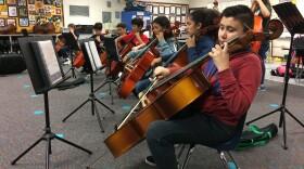 Anthony Medina plays cello with other Kellogg Elementary School students, Nov. 29, 2017.