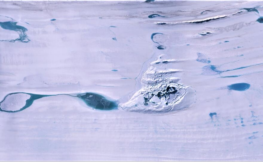 A huge lake of melted water collapses on the Amery ice shelf in the Antarctica in this undated photo