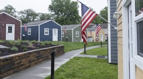The first Veterans Community Project campus in Kansas City, Mo. features 49 tiny homes for homeless veterans. The organization hopes to have similar villages in eight cities by the end of 2022.
